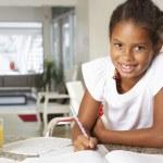 Girl Doing Homework In Kitchen — Stock Photo
