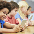 Pupils In Class Using Digital Tablet — Stock Photo #27553179