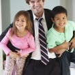 Children Greeting Father On Return From Work — Stock Photo #27553205