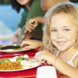 Elementary Pupils Enjoying Healthy Lunch In Cafeteria — Stock Photo