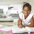 Stock Photo: Girl Doing Homework In Kitchen
