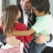 Stock Photo: Children Greeting Father On Return From Work