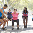 Group Of Exercising Street With Personal Trainer — Stock Photo