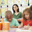 Stock Photo: Group Of Elementary Age Children In Art Class With Teacher