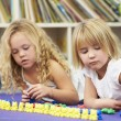 Two Elementary Pupils Counting Together In Classroom — Stock Photo #27553367