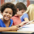 Pupils In Class Using Digital Tablet — Stock Photo #27553417