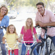 Family Cycling On Suburban Street — Stok fotoğraf