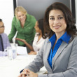 Portrait Of Businesswoman In Boardroom With Colleagues — Stock Photo #27553509