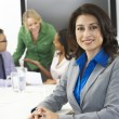 Portrait Of Businesswoman In Boardroom With Colleagues — Stock Photo