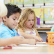 Group Of Elementary Age Children In Art Class — Stock Photo #27553529