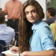 Stock Photo: Female Teenage Pupil In Classroom