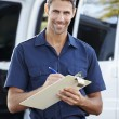 Portrait Of Delivery Driver With Clipboard — Stok fotoğraf