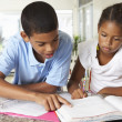 Two Children Doing Homework Together In Kitchen — Stock Photo