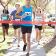 Stock Photo: Male Runner Winning Marathon