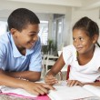 Two Children Doing Homework Together In Kitchen — Stock Photo #27553835