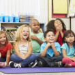Group of Elementary Pupils In Classroom — Stock Photo #27553865