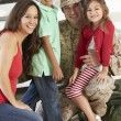 Stock Photo: Family Greeting Military Father Home On Leave