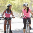 Two Women Cycling On Suburban Street — Stock Photo
