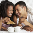 Couple Enjoying Breakfast In Bed — Stock Photo #27553991