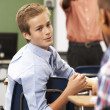 Two Male Pupils Talking In Class — Lizenzfreies Foto