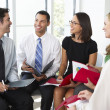 Stock Photo: Businesspeople Having Informal Office Meeting