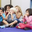 Group of Elementary Pupils In Classroom Touching Noses — Stock Photo