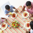 Overhead View Of Family Eating Meal Together — Stock Photo #27554075