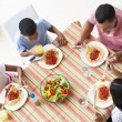 Stock Photo: Overhead View Of Family Eating Meal Together