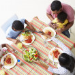 Overhead View Of Family Eating Meal Together — Foto de Stock