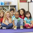 Group of Elementary Pupils In Classroom — Stock Photo #27554139