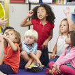 Stock Photo: Elementary Pupils In Classroom Learning To Tell Time