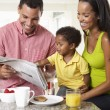 Family Having Breakfast In Kitchen Together — Stock Photo