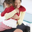 Stock Photo: Daughter Greets Mother On Return From Work