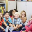 Group of Elementary Pupils In Classroom Touching Noses — Stock Photo #27554223