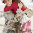 Daughter Greeting Military Mother Home On Leave — Stock Photo #27554325