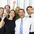 Portrait Of Business Team In Office Celebrating — Stock Photo #27554335