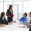 Businesswoman Conducting Meeting In Boardroom — Stock Photo