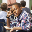Bored Male Teenage Pupil In Classroom — Foto de Stock