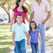 Stock Photo: Family Walking Along Suburban Street