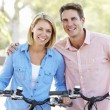 Couple Cycling On Suburban Street — Stock Photo