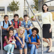 Group of Elementary Pupils Outside Classroom With Teacher — Stock Photo #27554553