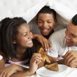 Family Enjoying Breakfast In Bed — Stock Photo