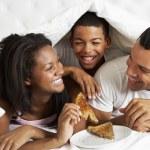 Family Enjoying Breakfast In Bed — Stock Photo #27554557