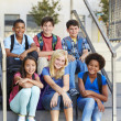 Group of Elementary Pupils Outside Classroom — Stock Photo #27554567