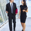 Stock Photo: Businessman And Businesswomen Walking Outside Office