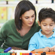 Elementary Pupil Counting With Teacher In Classroom — Fotografia Stock  #27554643