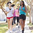 Group Of Female Runners Exercising On SuburbStreet — Stock Photo #27554645