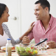 Stock Photo: Couple Eating Meal Together At Home