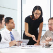 Stock Photo: Group Of Businesspeople Meeting In Office