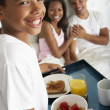 Son Bringing Parents Breakfast In Bed — Stock Photo